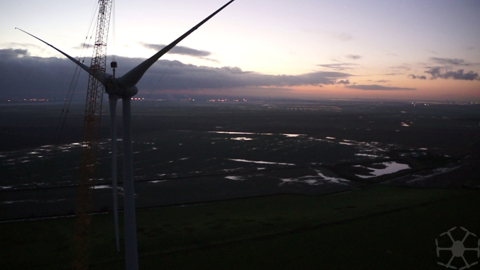 wind turbine blade lift at sunset